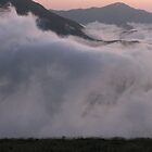 Sunset over clouds by damghani