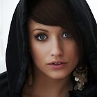 Girl in black hood with earing by raykirby
