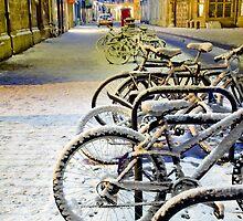 Snowy bikes in Cambridge by night by BeardyGit