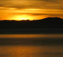 Last of sun reflecting the bay by kevin seraphin