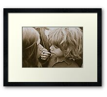 mom and son sharing  Framed Print
