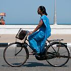 Cyclist in a blue sari. by Syd Winer