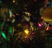Ornaments, lit only by the tree's lights by Roger-Cyndy
