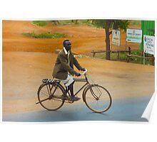 Man on a bicycle in Makindu, KENYA Poster