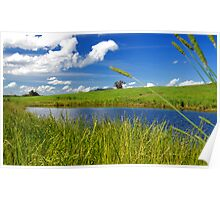 Full Dam Surrounded by Lush Green Fields Poster