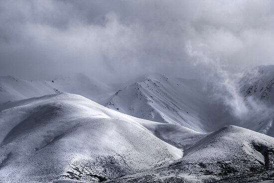 A storm sweeps over the Southern Alps by craftybadger