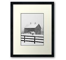 Barn in a Snowstorm Framed Print