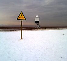 Lighthouse in the Snow by Mjay