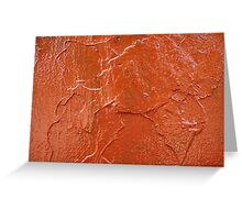 Thick and uneven layer of red paint on a wall closeup Greeting Card