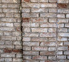 Fragment of a wall of an old red brick with white coating by vladromensky