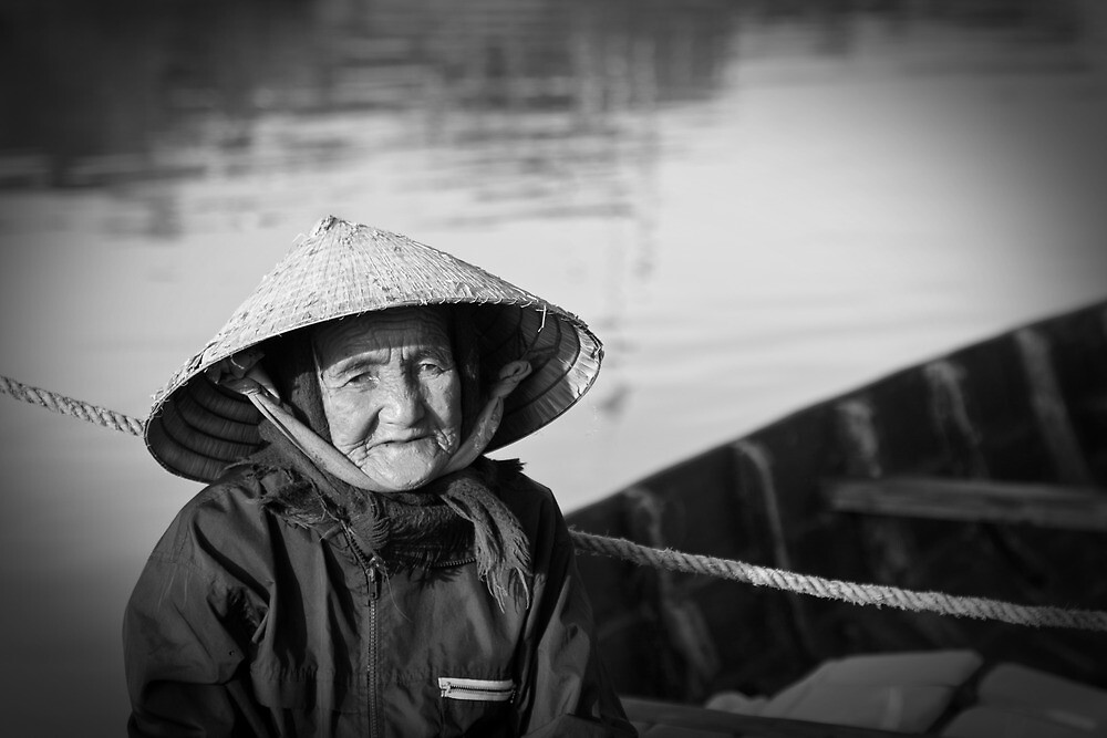 Vietnam - Begger on canoe in Hoi Ann by Chris Bishop