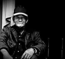 Vietnam - Portrait of man in back streets of Dalat by Chris Bishop