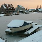 snow covered boat by LisaBeth