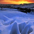 Snow formations at sunset by johnfinney