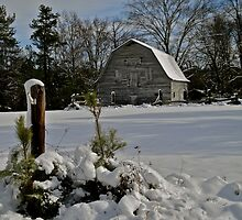 Abandoned barn in the snow by ashley hutchinson