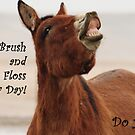 Get your kids to brush and floss! by Donna Ridgway