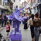 Purple Bike Man by Paul Benjamin