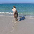 Footprints and hoofprints on the beach by JaanaWilson