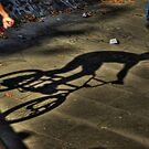 BMX biker shadow by Guy Carpenter
