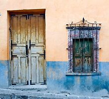 Door and Window on a Color Wall by Oscar Gutierrez