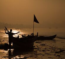 Repairing the fishing nets at sunrise by Madhav Mehra