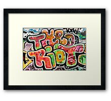 Abstract graffiti detail on the textured brick wall Framed Print