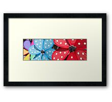 Handheld pinwheels – closeup Framed Print