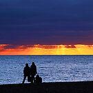 Brighton Beach - Watching the sunset. by John Dalkin