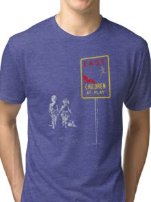 Beach playing games... Tri-blend T-Shirt