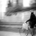 hannah riding her bike home from the market by moyo