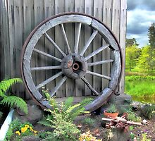 Historic wooden wagon wheel by Kerry  Hill