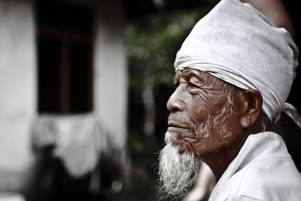 Bali - Indonesia: Elderly man in family commune by Chris Bishop