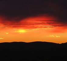Sunset over the Robledo Mountians (Another) by CynLynn