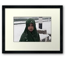 Young Boy and the Snowstorm Framed Print