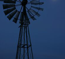 Full moon rising- a windmill silhouetted in the karoo by JulesM