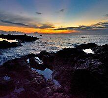 In barca alle prime luci del mattino by Andrea Rapisarda