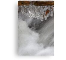 Icicles over the stream Canvas Print