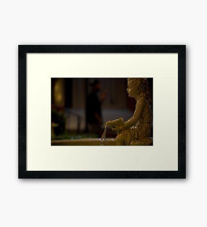 angel in the dark Framed Print