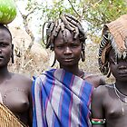 YOUNG MURSI GIRLS WEARING DIFFERENT HEAD DECORATIONS by Nicholas Perry