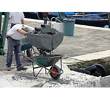 Concrete Pour into Wheelbarrow with Workmen Photographic Print