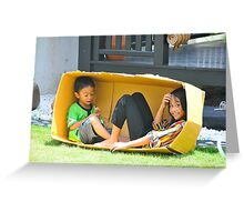 Kids playing in a box Greeting Card