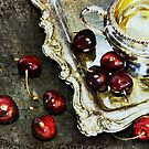 cherries on silver tray by olga  hutsul