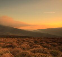 Sun sinks behind hill. by Fred Taylor