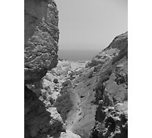 Rocks with Dead Sea in Background Photographic Print