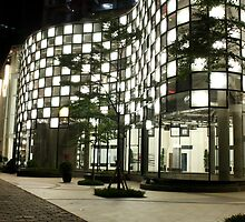The Epicentrum Walk (by night) by buildings