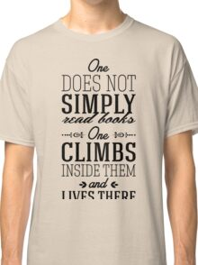 One does not simply read books - one climbs inside them and lives there. Classic T-Shirt