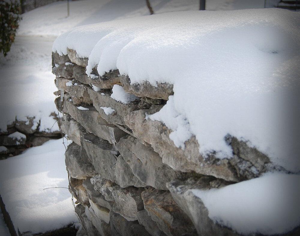 Snow on Rock Fence by Dave Chafin Photography