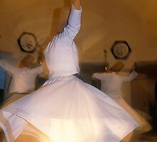 Whirling Dervishes in Cappadocia by Alex Cassels