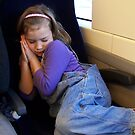 Snoozing on a Train Ride by wyvernsrose