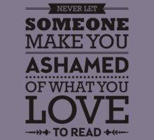 Never let someone make you ashamed of what you love to read. Kids Tee